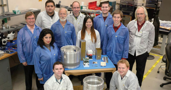 The TechEdSat team at the NASA Ames Research Center with a CubeSat satellite that incorporates NovAtel receiver technology.